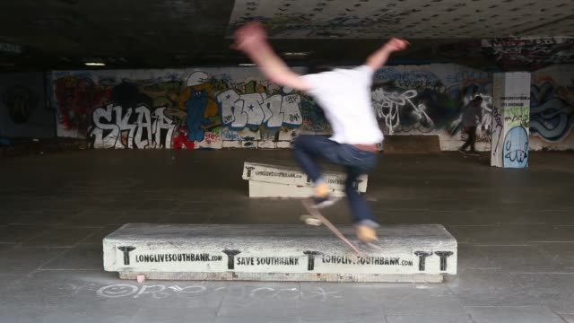 long shot skater performing tail grind skateboarding's south bank home under threat at southbank centre on may 18 2013 in london england - skateboard park stock videos & royalty-free footage