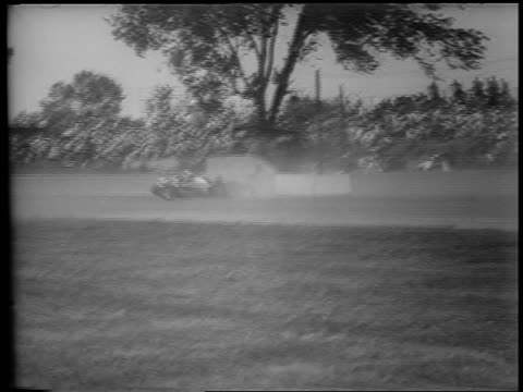 b/w 1953 long shot smashed car going backwards stopping on track / indianapolis 500 - 1953 stock videos and b-roll footage
