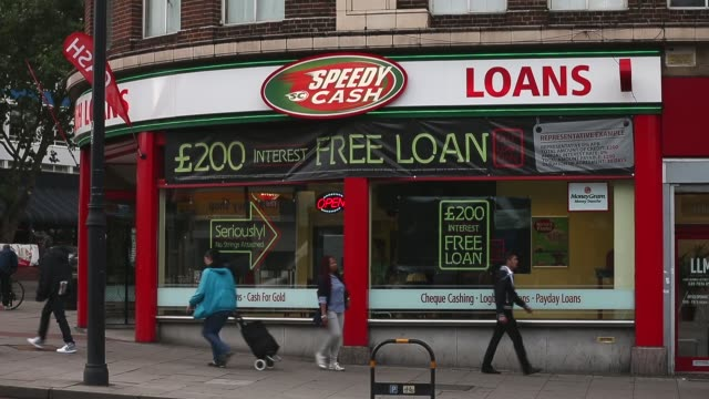 long shot speedy cash loan shop in brixton london payday loan stores are to face tougher regulations after moves proposed by the financial conduct... - pawnbroker stock videos & royalty-free footage