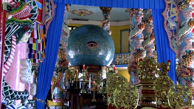 long shot sphere representing the divine eye of god at hole see altar in da lat shot on january 2016 - vietnam meridionale video stock e b–roll