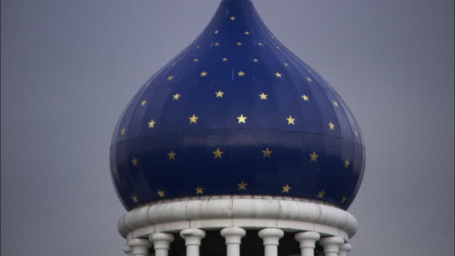 long shot static - a blue onion dome tops the colt armory in hartford, connecticut. / hartford, connecticut, usa - onion dome stock videos and b-roll footage