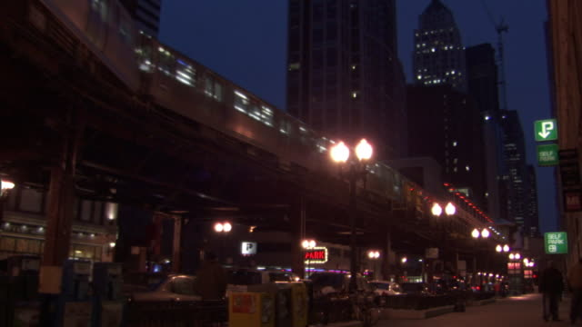 Long Shot static - An elevated train passes through Chicago at night. / Chicago, Illinois, USA