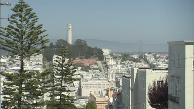 long shot static - coit tower dominates the coastal skyline of san francisco. / san francisco, california, usa - north beach san francisco stock videos & royalty-free footage
