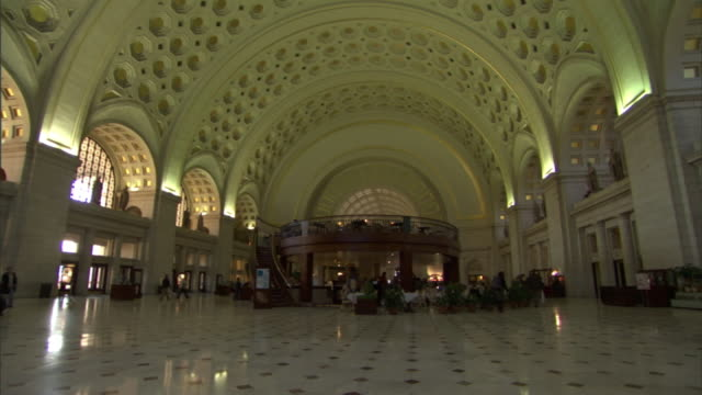 long shot static - commuters stroll near center cafe restaurant inside union station in washington, d.c. / washington, d.c., usa - arch stock videos & royalty-free footage
