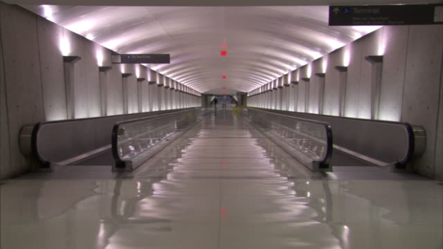Long Shot static - Two moving walkways are provided for travelers at Dulles International Airport. / Dulles, Virginia, USA