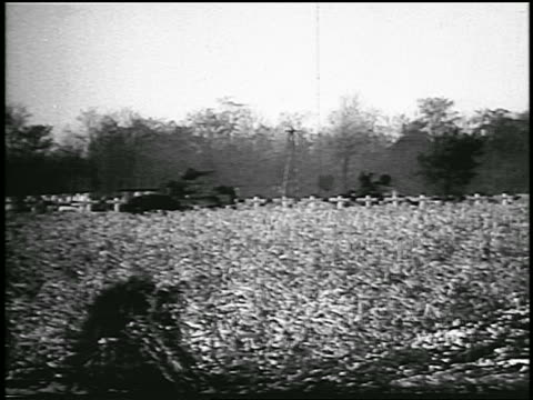 long shot tanks in field with trees in background / hungarian revolution / newsreel - 1956 stock-videos und b-roll-filmmaterial