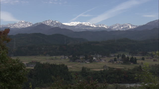 long shot: tateyama mountain range, toyama, japan. - satoyama scenery stock videos & royalty-free footage