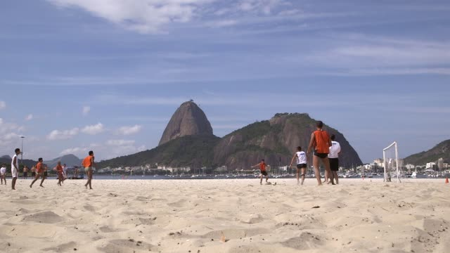 long shot team in orange shorts score a goal amateur teams play play football on botafogo beach rio de janeiro brazil on june 9 2013 - amateur stock videos & royalty-free footage