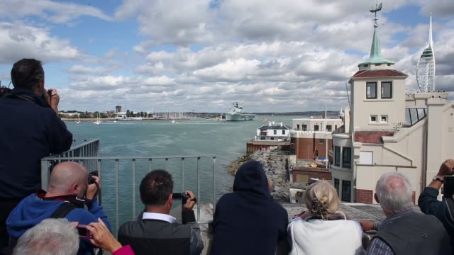 long shot the helicopter carrier hms illustrious departs portsmouth for a deployment to the mediterranean on august 12 2013 in portsmouth england... - hms illustrious r06 stock videos and b-roll footage