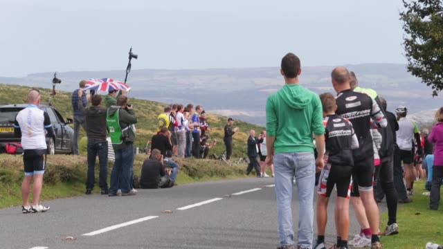 long shot the peloton with bradley higgins leading passes cheering fans stage six of the tour of britain made history this year as it was the first... - tour of britain stock videos & royalty-free footage