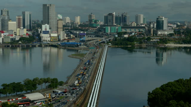 long shot time lapse of a busy traffic at the singapore causeway bridge - johor stock videos & royalty-free footage