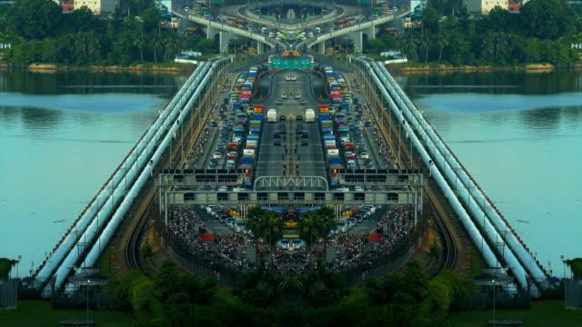 long shot time lapse of a busy traffic at the singapore causeway bridge - causeway stock videos & royalty-free footage