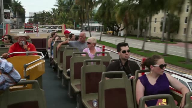 Long Shot Tourists enjoy the sights from onboard a Big Bus Tour double decker bus during a sightseeing trip to South Beach on August 15 2013 in Miami...