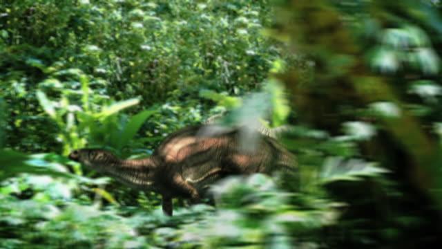 Long Shot tracking-left - A dramatization shows a Tyrannosaurus Rex chasing another dinosaur. / Chicago, Illinois, USA