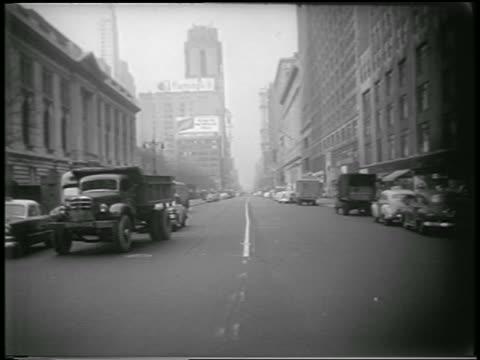B/W 1951 long shot traffic stopped on street during civil defense drill / NYC / newsreel