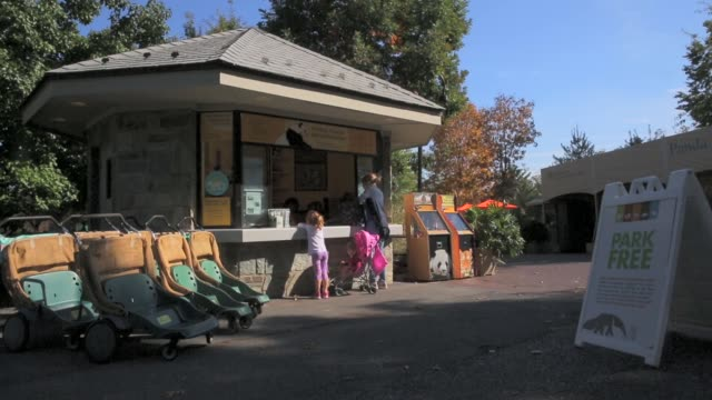 long shot visitors buy snacks at an information booth at the smithsonian's national zoological park washington dc october 18 2013 national zoo and... - smithsonian institution video stock e b–roll