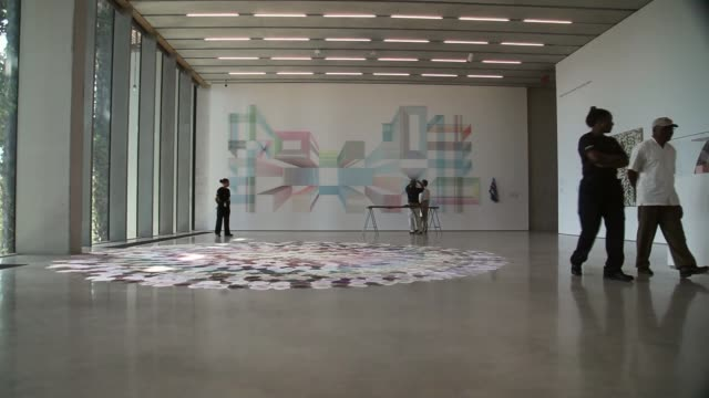 long shot visitors walk through a gallery during the opening day of the pérez art museum miami on december 4 2013 in miami florida the museum... - biscayne bay stock videos & royalty-free footage