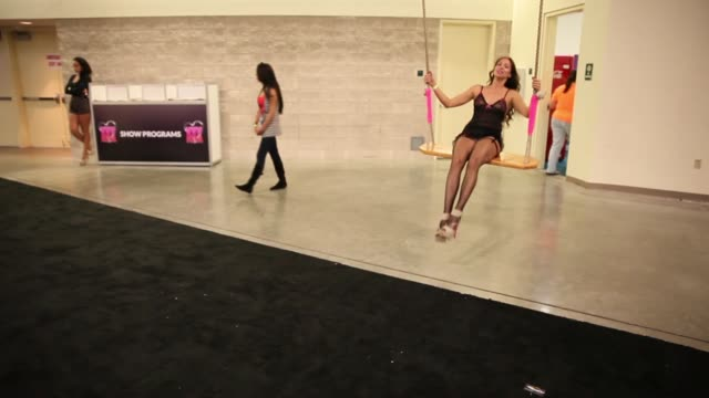 Long shot woman swinging on a swing at Expo Adult Industry Stars And Exhibitors Gather For Trade Show on May 31 2013 in Fort Lauderdale Florida