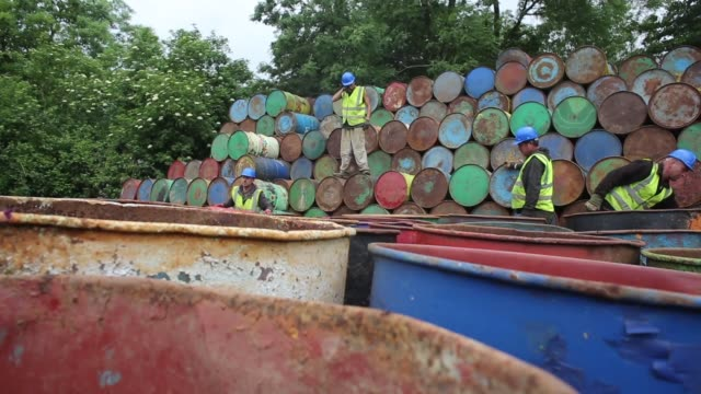 Long shot workers unstacking barrels in preparation for the festival
