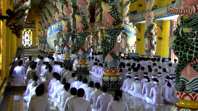 long shot worshippers of cao dai religion attending a mass shot on january 2016 - theology stock videos and b-roll footage