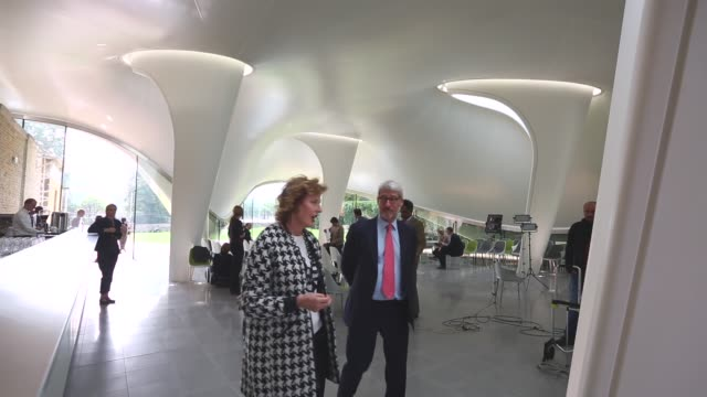 vídeos y material grabado en eventos de stock de long shot, zaha hadid and jeremy paxman conversing at the serpentine sackler gallery. members of the public admire the redeveloped serpentine sackler... - jeremy paxman