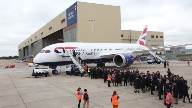 long shots cabin crew wait to enter the new boeing co 787 dreamliner aircraft operated by british airways at heathrow airport in london a logo sits... - boeing 787 stock videos and b-roll footage