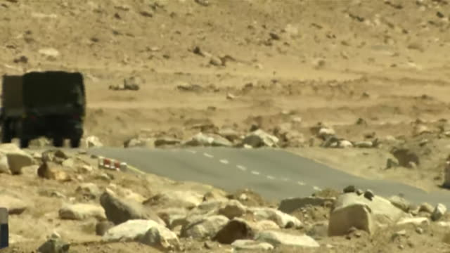 long shots of indian army vehicles moving in the ladakh valley a convoy of army trucks can be seen plying on the roads - indian army stock videos & royalty-free footage