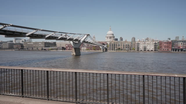 a long side ways dolly shot along the river thames and under the millennium bridge, london - dolly shot stock videos & royalty-free footage