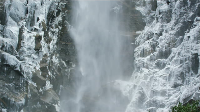 long, slow tilt up bridal veil falls, yosemite national park, close up, slomo - californian sierra nevada stock videos and b-roll footage