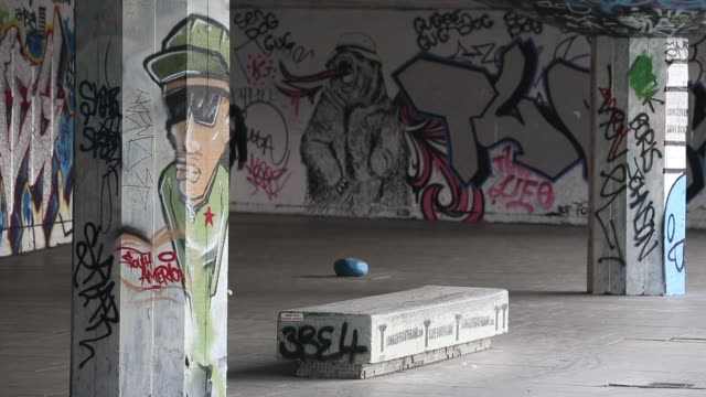 long sot of multiple skaters performing tricks skateboarding's south bank home under threat at southbank centre on may 18 2013 in london england - skateboard park stock videos & royalty-free footage