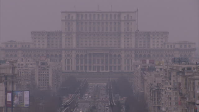 A long straight road leads to the Palace of Parliament in Bucharest. Available in HD