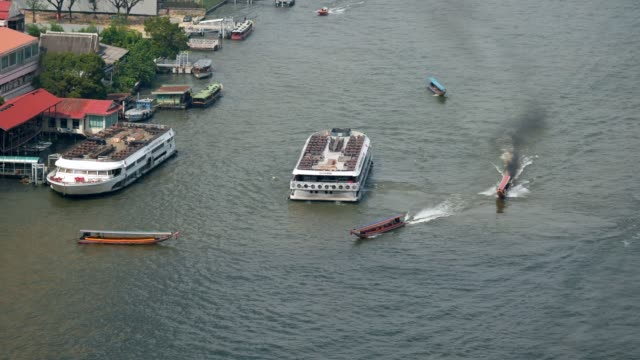 long tail boat transport in chao phraya river - river chao phraya stock videos & royalty-free footage