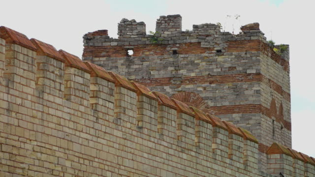 long theodosian walls of constantinople and a large turret - istanbul video stock e b–roll