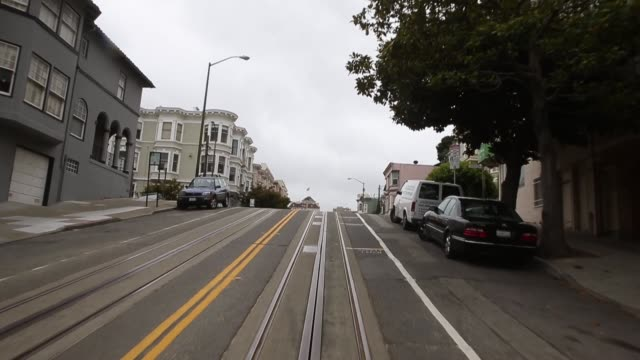Long tracking shot from the front of the cable car Tourists come from all over the world to see San Franciscos iconic cable cars the last manually...
