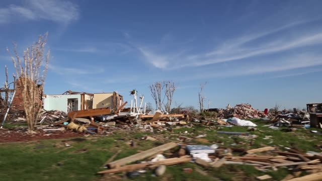 long tracking shot of destroyed houses series of tornadoes rips through oklahoma city area on june 01 2013 in oklahoma city oklahoma - oklahoma stock-videos und b-roll-filmmaterial