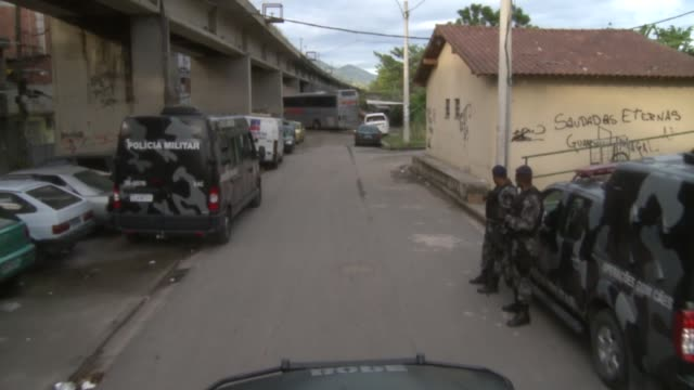 long tracking shot view off of bope truck driving through caju during invasion - 陸軍点の映像素材/bロール
