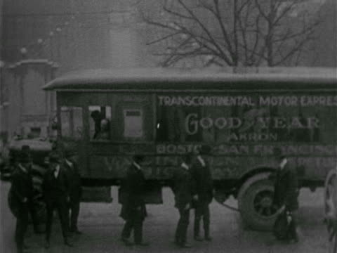 long truck w/ men inspecting good year air filled tires, men standing behind unidentified man knocking on truck, smiling, man stepping out of truck,... - 1918 stock videos & royalty-free footage