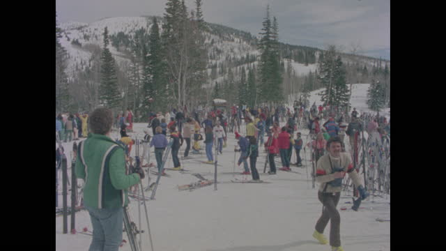 long view crowd of skiers on mountain top - ski resort stock videos & royalty-free footage