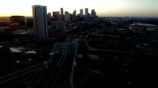 long view down iconic view of denver colorado skyline by the air - colorado stock videos & royalty-free footage