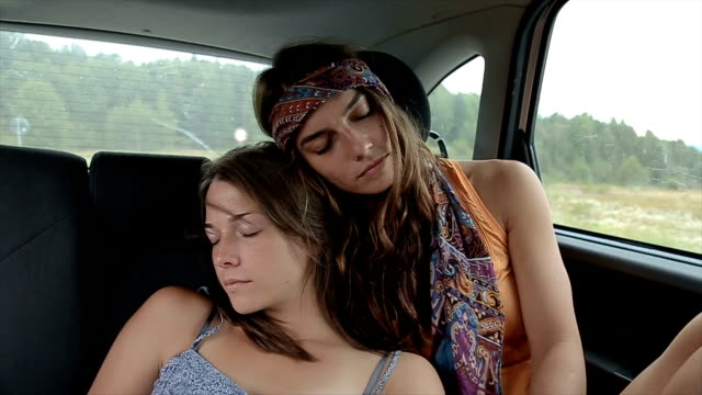 long way,two girls sleeping in the car on the backseat - comfortable stock videos & royalty-free footage