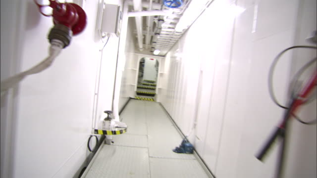 a long, white corridor leads to a boiler room. - boiler stock videos & royalty-free footage