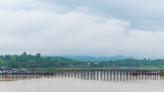 Long Wooden Bridge with Nature Background in Cloudy Day, Time lapse video