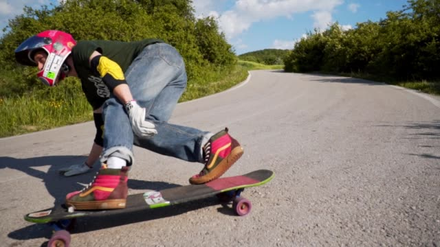 longboard rider riding downhill - professional sportsperson stock videos & royalty-free footage