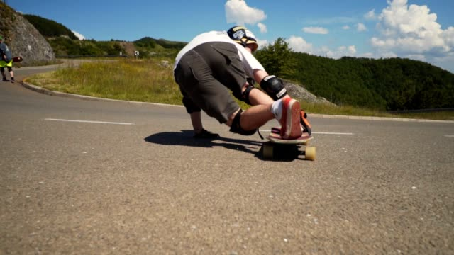 longboard rider riding downhill - moving down stock videos & royalty-free footage