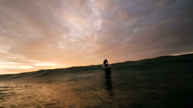 longboard rides wave - channel islands england stock videos & royalty-free footage