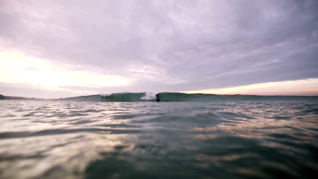 longboard rides waves - channel islands england stock videos & royalty-free footage