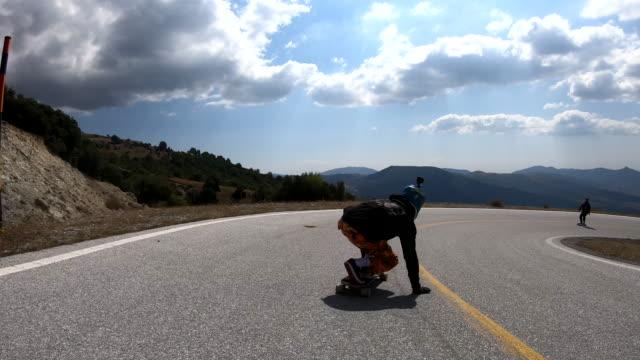 longboard skating is his addiction - longboarding stock videos & royalty-free footage