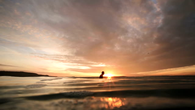 longboard waits and paddles - waiting stock videos & royalty-free footage