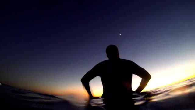 longboarder after sunset