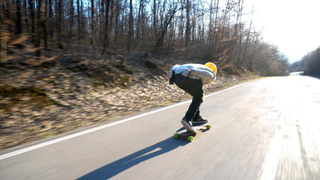 longboarder going down hill - moving down stock videos & royalty-free footage